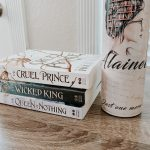 Photo of The Cruel Prince book series consisting of three books, and a coated stainless steel tumbler with books.